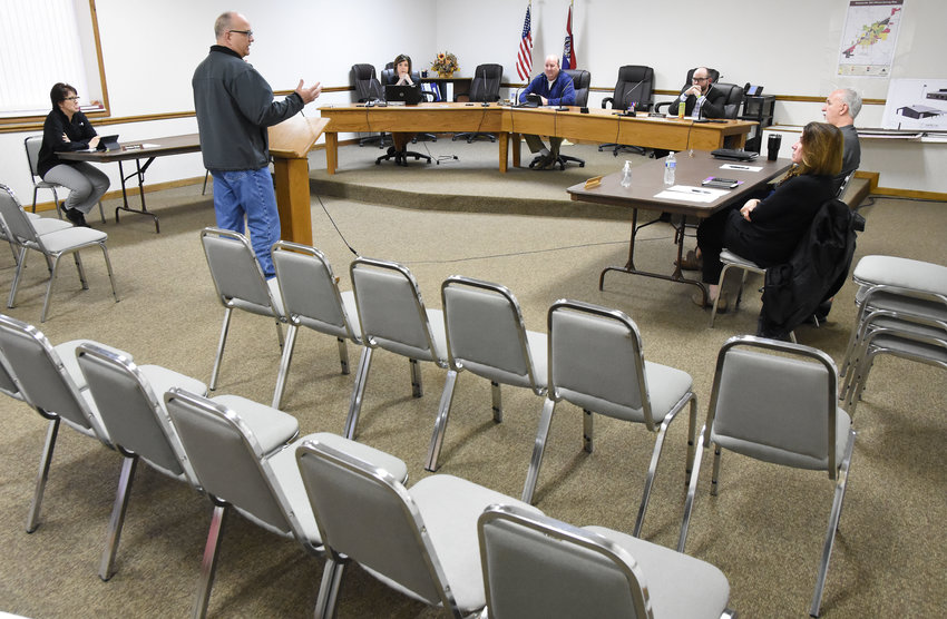 """Owensville's Board of Aldermen met March 23 at City Hall in their regular meeting room but with a very spread out """"social distancing"""" configuration. City Marshal Robert Rickerd gives his report to city staff and aldermen seated at three separate tables to give each of the elected officials and employees plenty of room between them. Aldermen are expected to conduct their scheduled April 6 meeting by a remote conference call system. Details had not been finalized as of 5 p.m. Tuesday when City Hall closed for the day. Public access to Owensville City Hall has been restricted for the past two weeks. Bland officials authorized a similar closure March 18."""