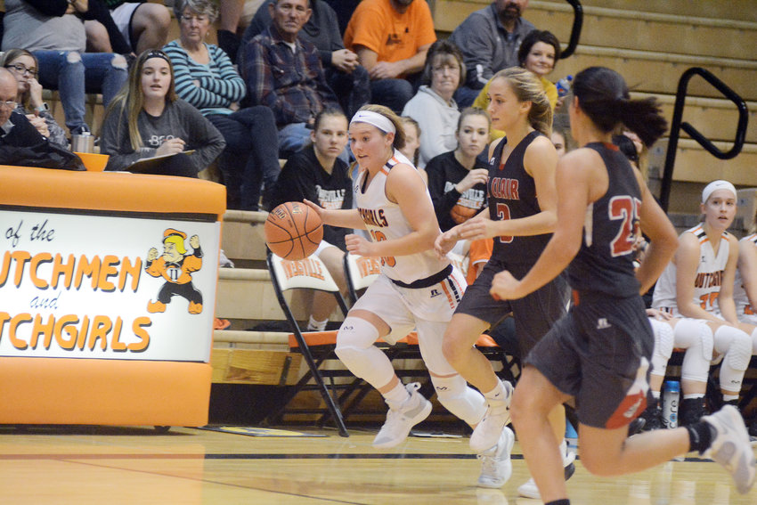 Driving (below, far left) past a pair of Lady Bulldog defenders, Landolt posted a stat line of two points, three rebounds, two assists and two steals against St. Clair.