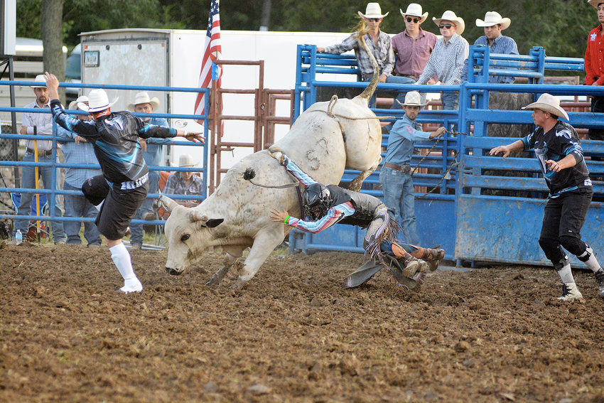 Caden Moss (above, center) hangs on to the best of his ability during the annual bull riding event at the 2019 Gasconade County Fair's opening night on the lower field of Memorial Park. Moss died from injuries sustained back on Monday, April 6 in a two-vehicle accident near Wichita, Kan.