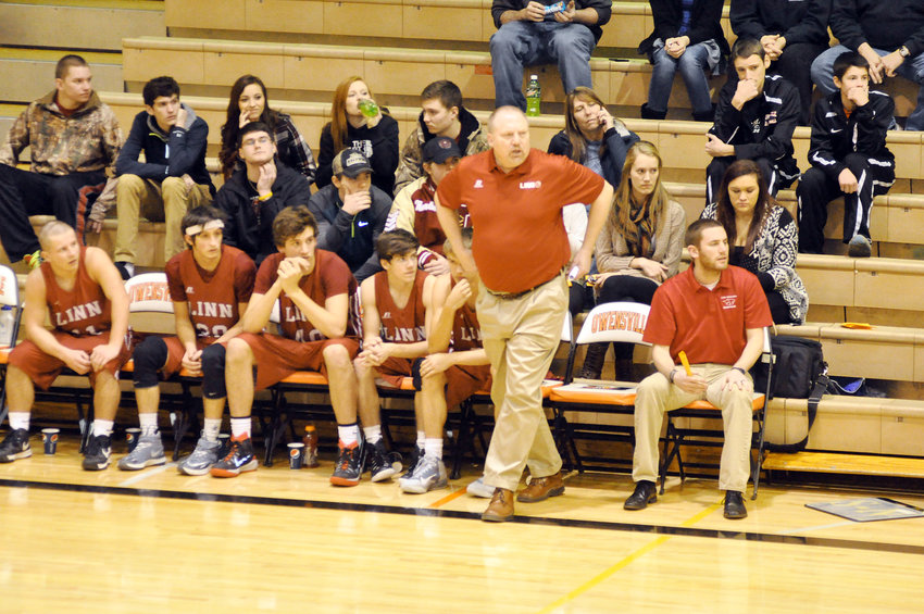 Greg Koetting (above, standing, far right) is shown coaching Linn's Wildcats during the 2015 Owensville Varsity Boys Basketball Tournament. Prior to his stop at Linn, Koetting was the head girls basketball coach at Belle before spending the past three seasons at Vienna High School as boys head basketball coach.