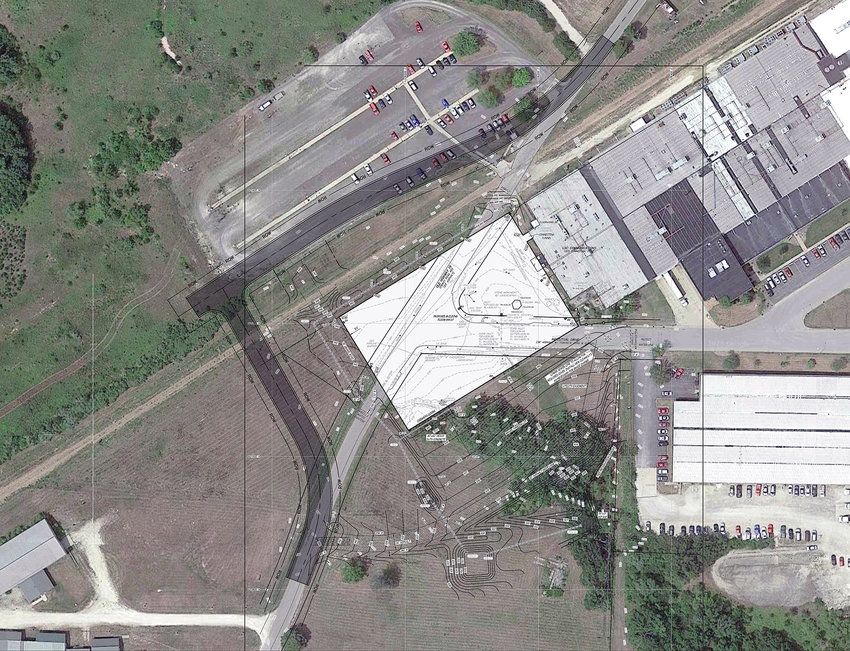 An engineer's drawing of the proposed LSC Communications printing plant addition shows the new building's location (white rectangle) along with the alignment of a new roadbed to be constructed to connect Springfield with Old Highway 19 (dark shaded line). The John Paul and Nancy Quick property is on the lower left.