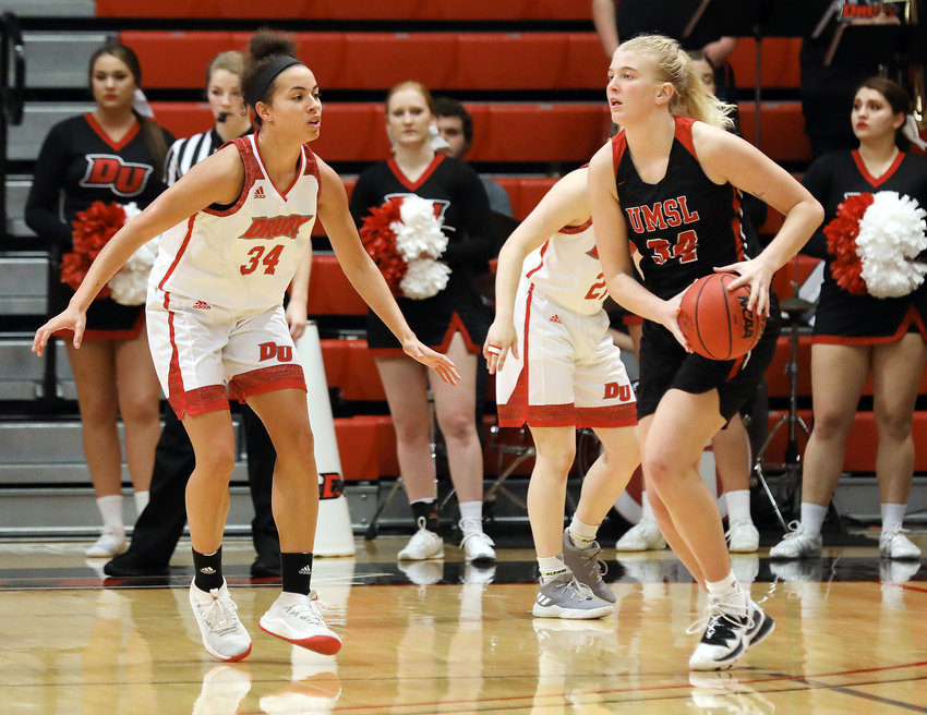 Breanna Diestelkamp (above, center) attacks the basket for the University of Missouri - St. Louis (UMSL) Lady Tritons last winter during her freshman season. Diestelkamp was the only freshman playing for UMSL.