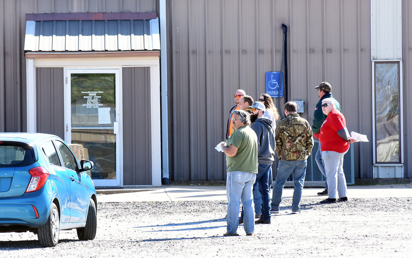 A line had formed by 9 a.m. Saturday for area residents doing business with the Owensville License Fee office operating from the Farm Bureau building. A limited number of customers, four at one time, were allowed in the building and those waiting outside were socially distancing between themselves by maintaining spacing of about 6 feet apart. Driver examinations are resuming this week at the VFW Hall.
