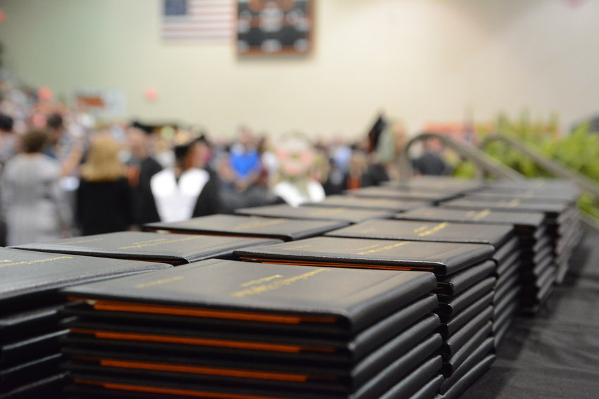 Diplomas lined up on a table during Owensville High School's 2017 graduation ceremony.