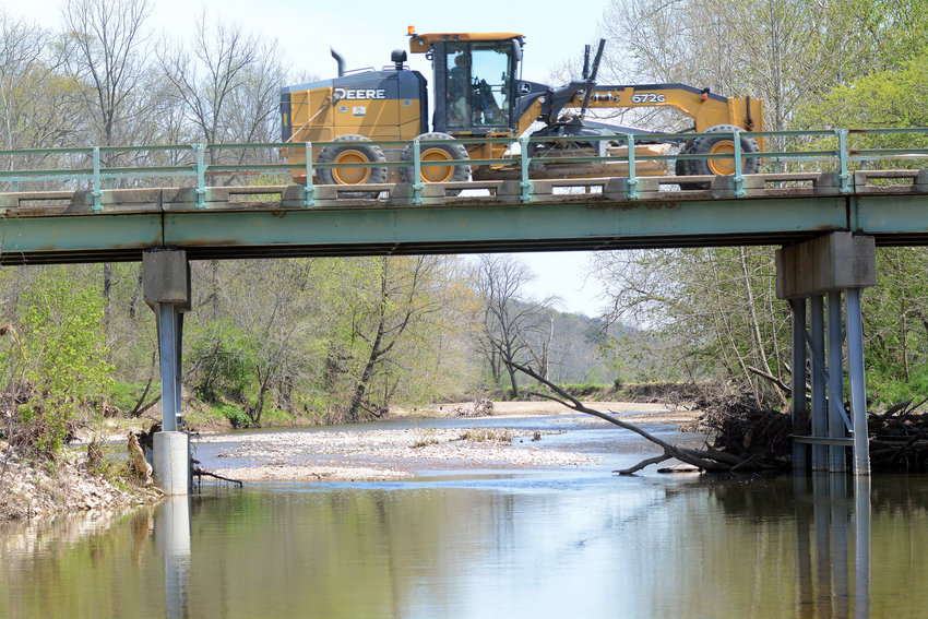A Gasconade County grader crosses Third Creek on the Route A bridge in April.