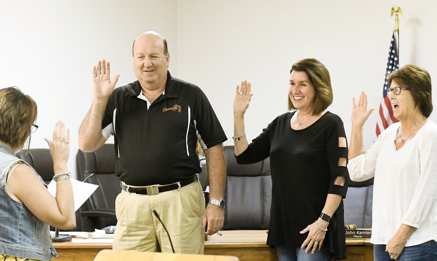 OWENSVILLE ELECTED officials John Kamler, Cathy Lahmeyer and Denise Bohl are sworn in Monday to their respective offices as mayor, Ward 1, and Ward 2 aldermen following the June 2 Municipal Election. All three ran unopposed.