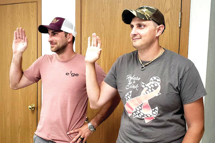 Freeburg trustees Dale Struemph, left, and Shane Zimmer, are sworn in at last Monday's meeting.
