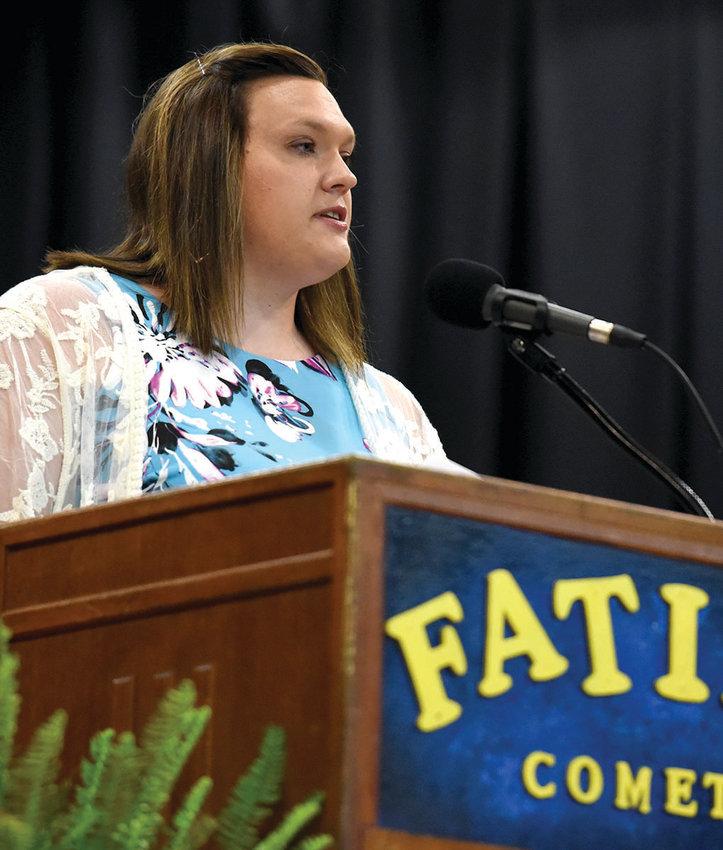 Fatima graduate and R-3 business teacher Andrea Brune on Saturday speaking to graduates.