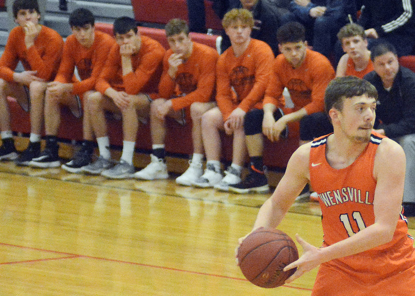 Daxton Mehrhoff handles the basketball during his senior season of Owensville Dutchmen basketball under former head coach Todd Rehmert against Cuba's Wildcats in the 2020 Belle Boys Basketball Tournament. Mehrhoff will graduate with the rest of the Owensville High School Class of 2020 this weekend at Dutchmen Field.