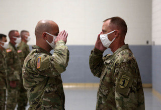 CPT Wieberg saluting Brig. Gen. Levon Cumpton the Missouri National Guard Adjutant General.