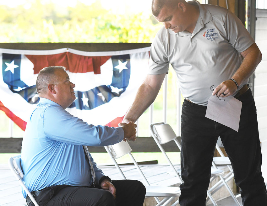 Gasconade County Sheriff Candidates shake hands at the recent Political Forum held at White Mule Winery in Owensville.