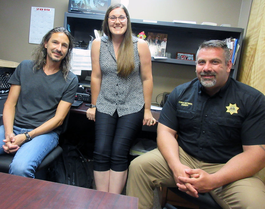 Samantha Maddison, MRPC senior community development specialist, stands between Dr. Sean Seibert (left) and Maries County Sheriff Chris Heitman. Seibert has developed a Rehabilitation through Innovation program to help jail inmates realize their assets and abilities to help them transition from jail to employment. Sheriff Heitman supports the effort to help lessen the revolving door at the county jail.