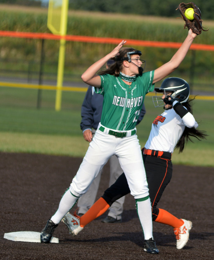 Kaitlin Nelson is narrowly forced out at second base after a fly ball dropped in front of her in the infield during Owensville's 12-6 win Saturday over New Haven in the opening game of the Owensville Softball Tournament at OHS Field.