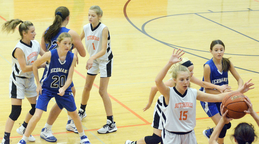 Jenna Breedlove (far right) defends the inbounds pass for Owensville during their season-opening 32-21 victory Monday night against Hermann's Lady Bearcats at Owensville Elementary School.