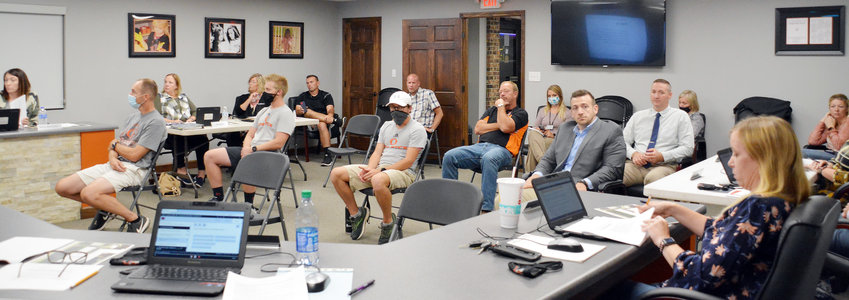 Gasconade County R-2 School District Board of Education members, administrators, and coaches covered numerous issues Monday related to the COVID-19 pandemic. Several coaches and both administrators at the middle school (in back) wore face masks.