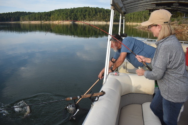 Michelle James and her first catfish, netted by Jim Spencer.