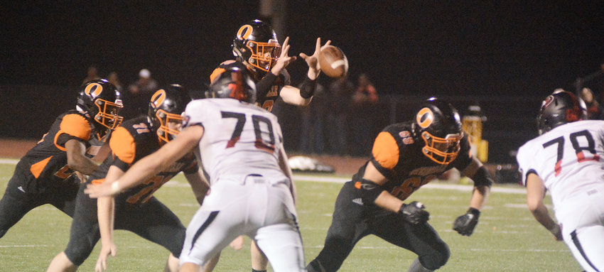 Blake Elliott (center) catches the snap in the fourth quarter of Owensville's 53-13 Four Rivers Conference (FRC) football victory Friday night over Union's Wildcats at Dutchmen Field. Other Dutchmen (above, from left) in on the play include Zibbie Whitaker, Kyle O'Neal and Owen Holtzer. OHS defeated Union 28-0 in Monday night's JV game at Union.