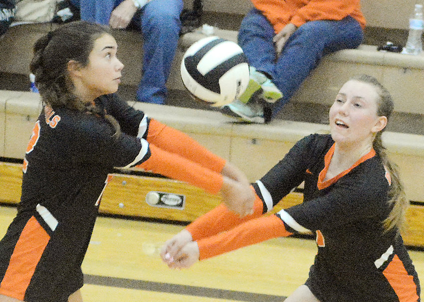 Kylie Kitchen and Grace McFalls (from left) both try to bump a ball at the same time during Owensville's varsity volleyball match last Tuesday against New Haven's Lady Shamrocks. OHS won all three levels against New Haven. Owensville's final home match of the season will be Tuesday, Oct. 20 against Hermann starting at 4:30 p.m.