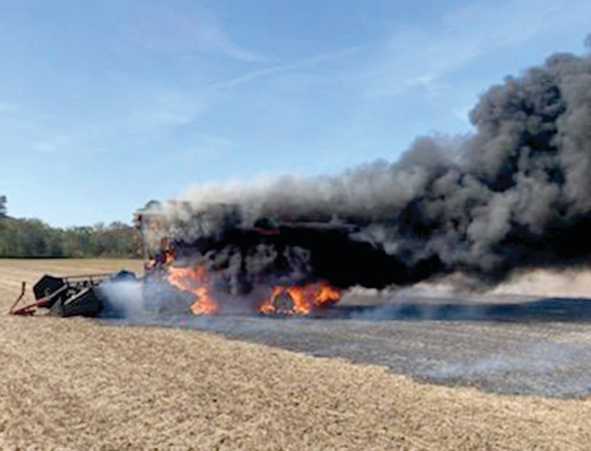 Firefighters used about 2,000 gallons of water to extinguish Steve Morfeld's combine during an incident last Wednesday.