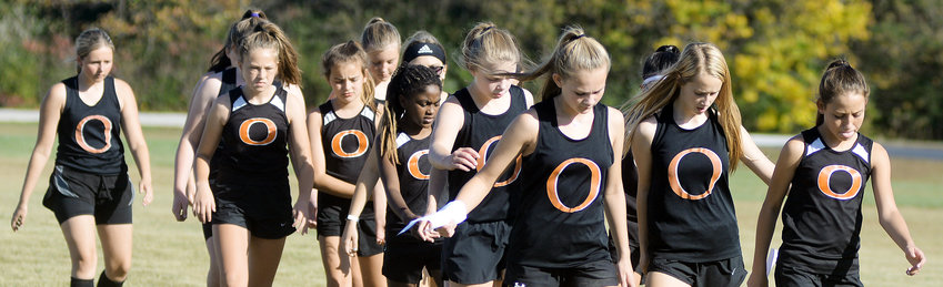 OMS Dutchgirl cross country team members warm up prior to their race last Tuesday afternoon during the Owensville Cross Country Invitational held on the Gasconade County R-2 campus. Yesterday's (Tuesday) Four Rivers Conference (FRC) Cross Country Meet was postponed due to forecasted inclement weather and rescheduled for tomorrow (Thursday) beginning at 2:30 p.m., at New Haven City Park.