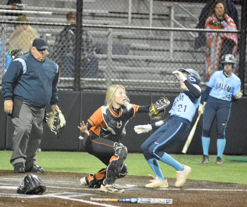 Halie Boyer (center) narrowly misses tagging out Salem's Tatum Hatridge during Owensville's 9-5 loss to the Lady Tigers in eight innings during the MSHSAA Class 3, District 3 Softball Tournament held last week at Sullivan High School's Sullivan Bank Ball Park.