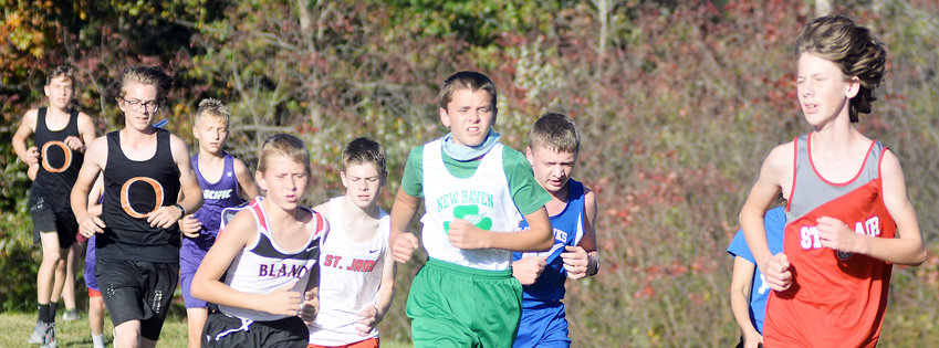 Garrett Gehlert (center) runs with a pack of harriers during the middle school boys race.