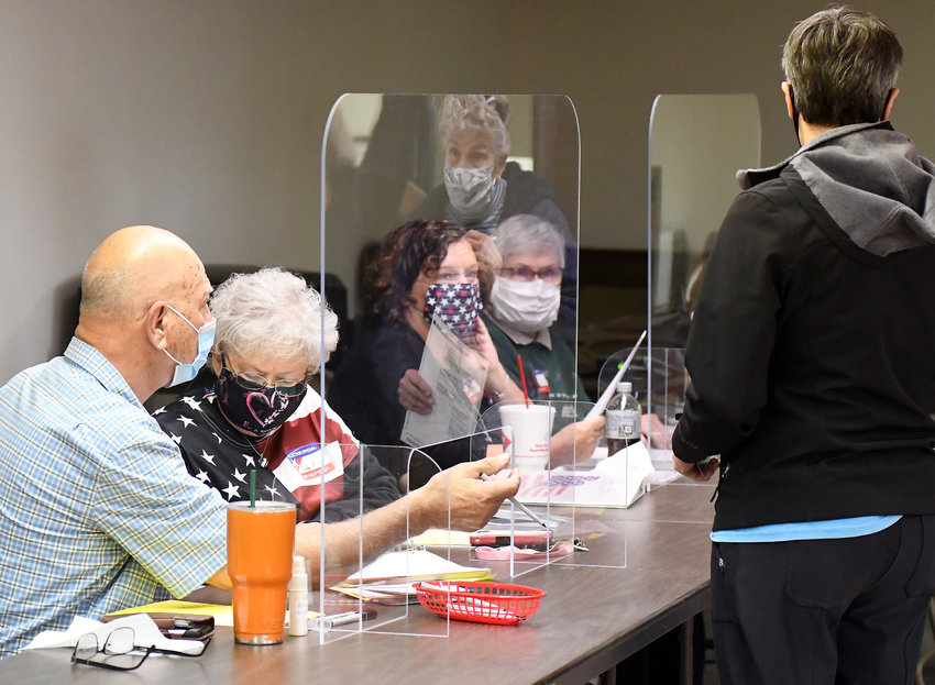 THIRD CREEK election judges (above) David Sprecker, Marilyn Rademacher, Melanie Adkison, and Phyllis Verhulst checked in nearly 100 voters by 8:15 a.m.