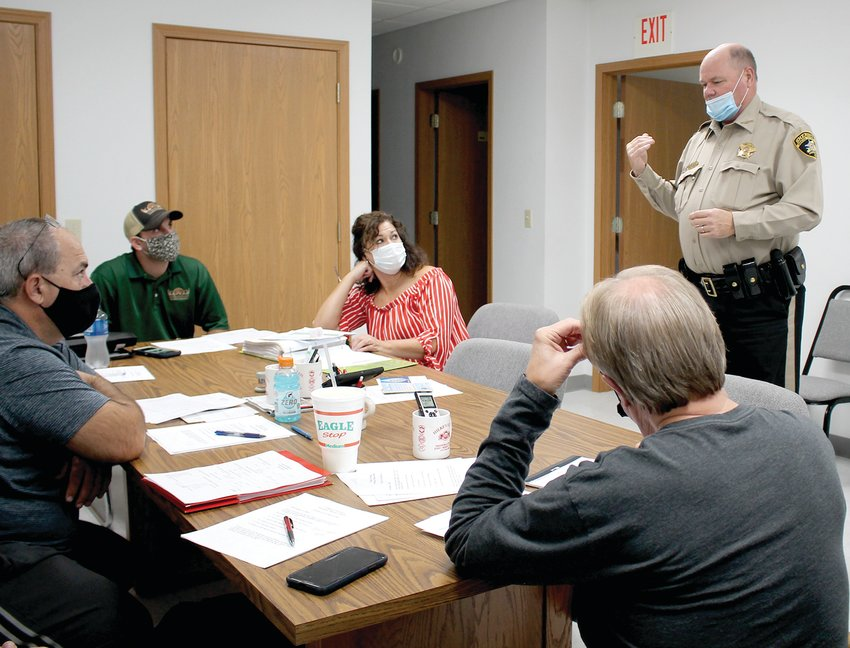 Sheriff Mike Bonham speaks with Freeburg trustees at their Nov. 9 meeting about ordinance enforcement options within the village limits.