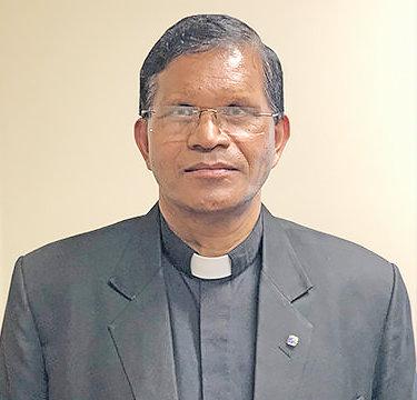 Rev. Basil Tigga