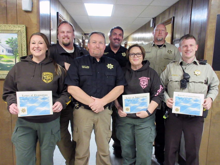 The Maries County Sheriff's Office recently recognized staff members (front row, from left) Corporal Elizabeth Thornton, Major Scott John, Jailer Shannon Fannon and Deputy Michael Sasseen; (back row, from left) Jailer/Dispatcher Shane Sweno, Sheriff Chris Heitman and Lt. Mark Morgan.