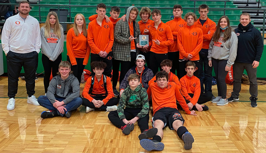 Owensville Dutchmen wrestlers and coaches gathered for a team photo with the second-place plaque following their 4-1 finish Saturday at the Ste. Genevieve Duals Wrestling Tournament. OHS wrestling is now out of action for the next two weeks due to a positive COVID-19 test within the program.