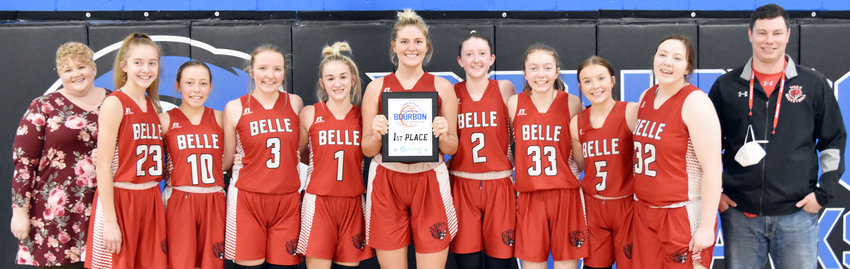 Belle's Lady Tigers proudly display their championship plaque from the Battle in Bourbon Girls Basketball Tournament Saturday night following their 57-53 victory in the title game over Liberty Christian.