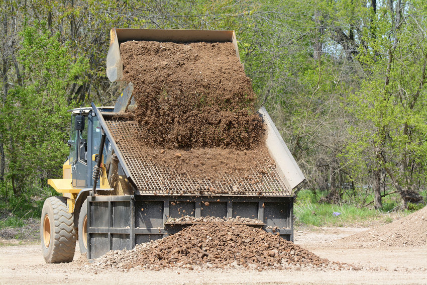 A Gasconade County Road and Bridge Department employee screens gravel in April 2020 at a stockpile off of Route A near Third Creek. The department's preliminary budget request for 2021was cut $300,000 by county commissioners.
