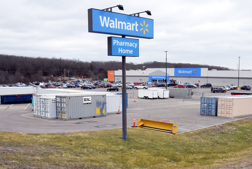 Shipping containers to be used during a remodeling project at the Owensville Walmart store are positioned on the store's parking lot.