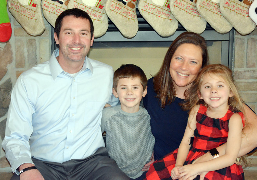Staci and Devin Johnson with their children, Ezekial, 6, and Evelyn, 4.