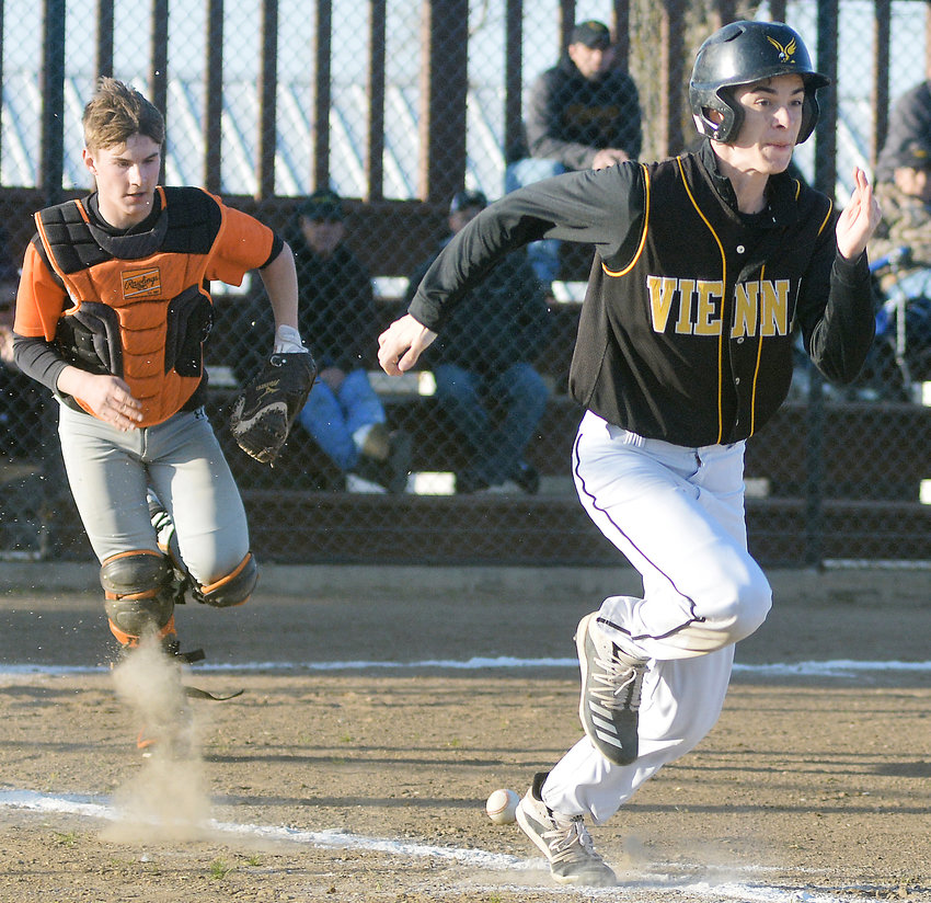 Deekin Wagner (right) runs down the first-base line after laying down a bunt for Vienna's baseball Eagles last Wednesday in home action at Vienna City Park against Waynesville's Tigers.