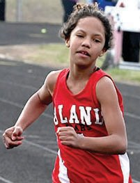 Piper Marsee sprints down the track in the 100-meter dash earlier this season at Linn.