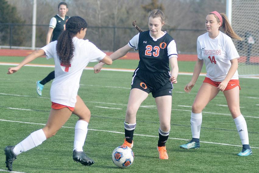 Kiana Guerrero (center) defends against Union's Lady Wildcats in recent Dutchgirl soccer action at Dutchmen Field.
