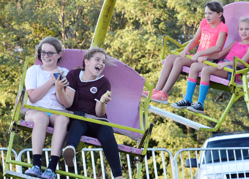 Fairgoers enjoy a spin on one of the rides at the 2019 Maries County Fair.