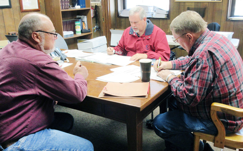 Maries County Commissioners Doug Drewel and Ed Fagre met with Mark Hayes of The Maries County Bank last week.