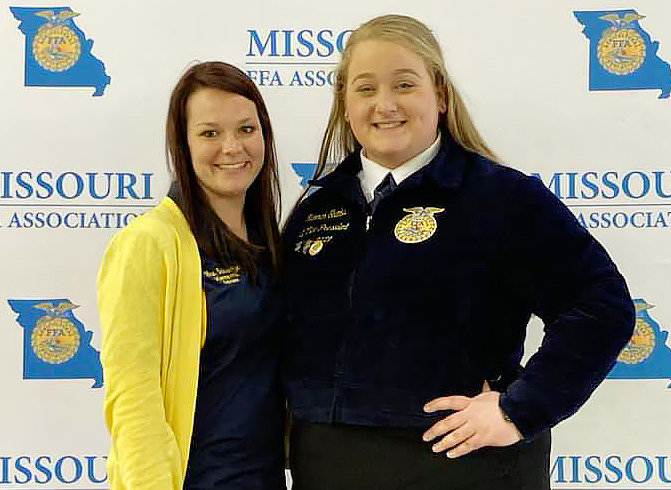 Vienna FFA Advisor Sara Schwartze (above, left) stands alongside newly elected State FFA Officer Hannah Shanks.