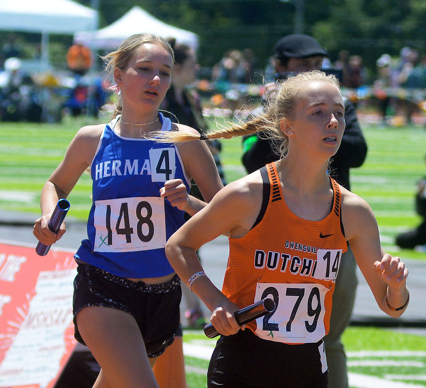 Mekayla Gibson (at right) runs her leg of the Class 3 Girls 4x800-meter relay staying ahead of Hermann's Morgan Miller during Saturday's state meet held at Jefferson City High School's Adkins Stadium. Gibson placed fifth in the Class 3 Girls 3200-meter run held prior to the 4x800m relay.