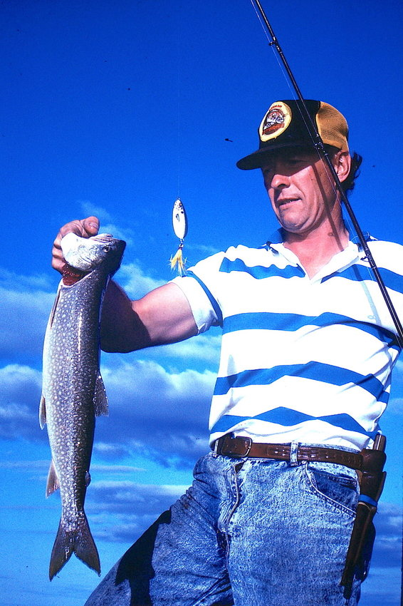 A photo from 30 years ago of Tinker and a lake trout.