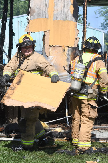 Owensville firemen were assisted by Hermann Fire Department personnel with extinguishing an August mobile home fire caused by a suspected squatter burning a candle for light.