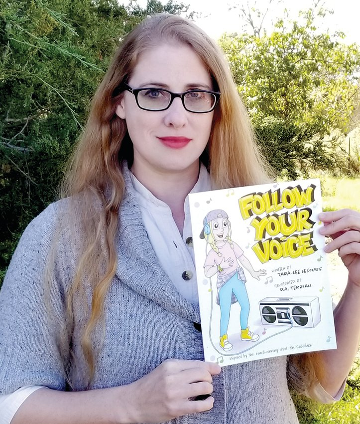 """Local author and illustrator D.A. Terriah with her book, """"Follow Your Voice."""""""