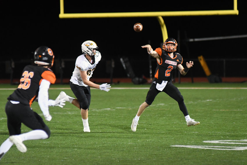 Brendan Decker (above, far right) throws a pass down the field to Owensville wide receiver Bryce Payne (above, far left) during Owensville's 35-6 victory Friday night over Sullivan on their Dutchmen Field home turf. OHS hosts St. Clair Friday for senior night beginning at 7 p.m.