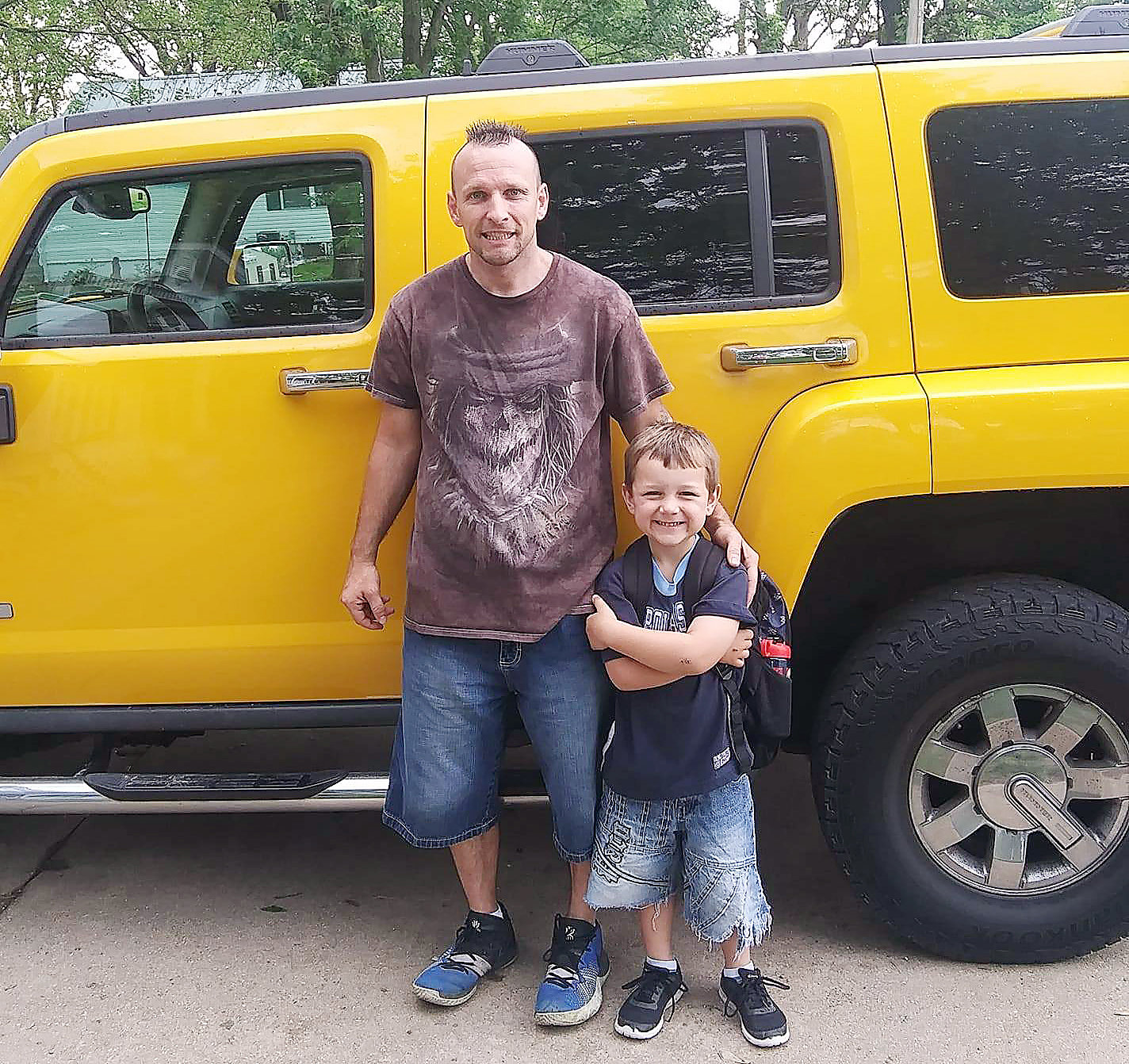 Jason Barton and Bentlee Turner in an recent photograph from Brenda Turner's Facebook page beside Barton's Humvee.