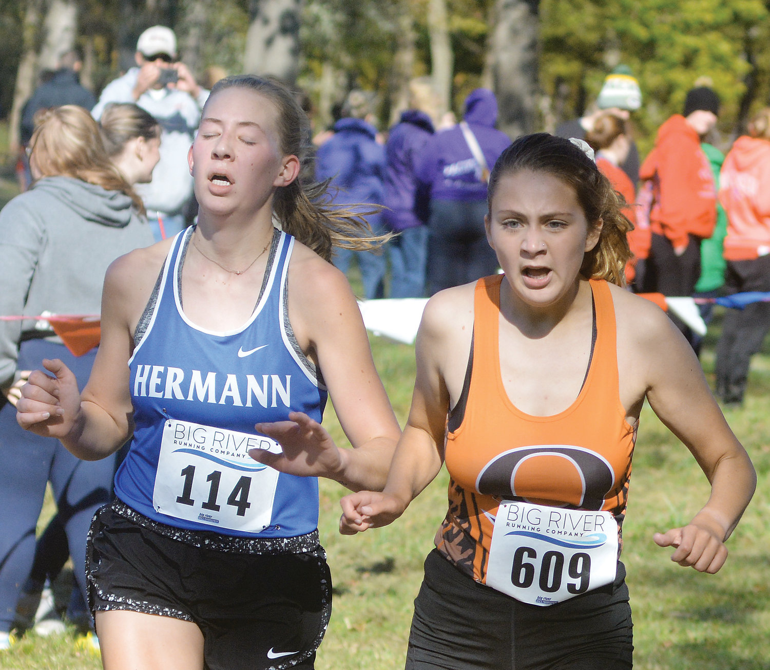 Kyra Binkhoelter (right) edges Hermann's Ava Engemann at the finish line in the varsity girl's race during last Tuesday's Four Rivers Conference (FRC) cross country meet hosted by St. James High School at Maramec Spring Park south of St. James. Binkhoelter joined Dutchgirl seniors Sophia Ashner, Kendra Hults, Macy McKinney and Molli Gross as four-time FRC team champions in cross country.