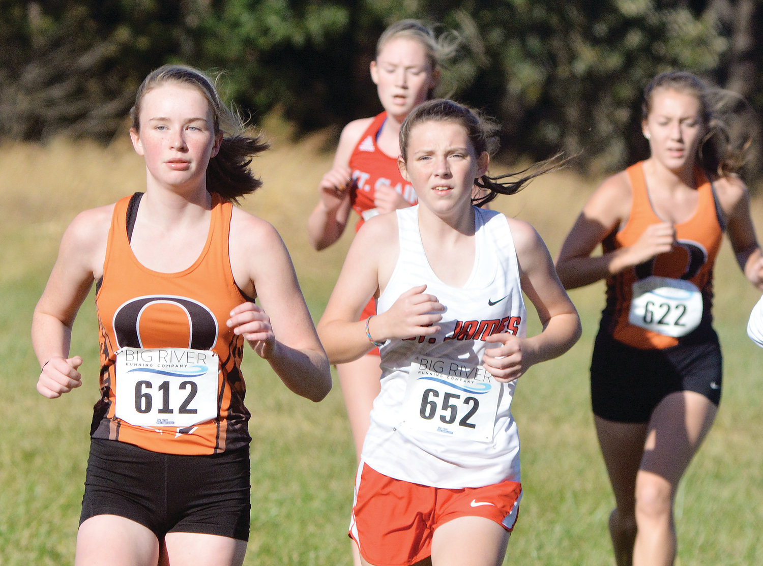 Kiera Finn (far left) leads the front of the pack during the junior varsity girl's race last Tuesday at the Four Rivers Conference (FRC) Cross Country meet held south of St. James at Maramec Spring Park.