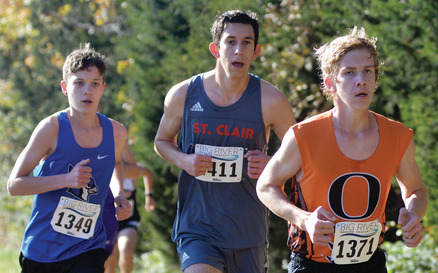 Harm Rademacher (far right) races along a tree line during the Class 3 boys race.